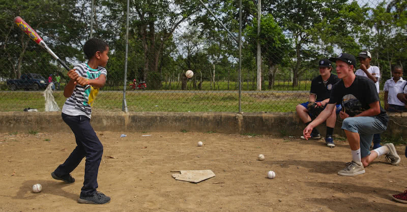 GBA Players providing a free baseball clinic to local kids in the Dominican republic