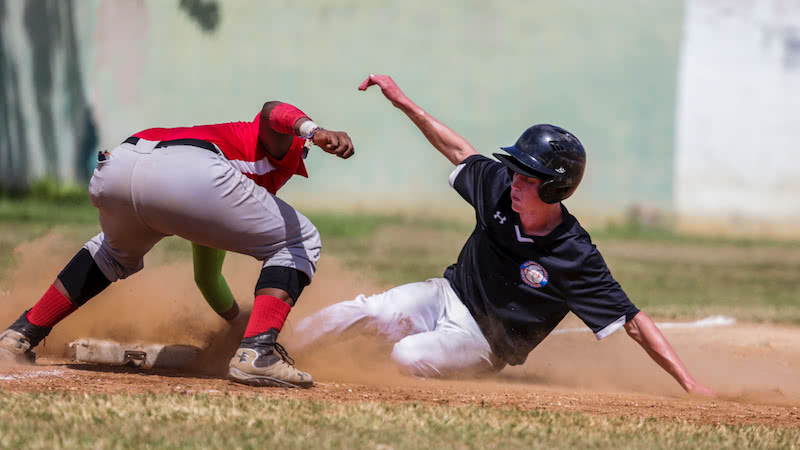 player sliding into base in a game of baseball
